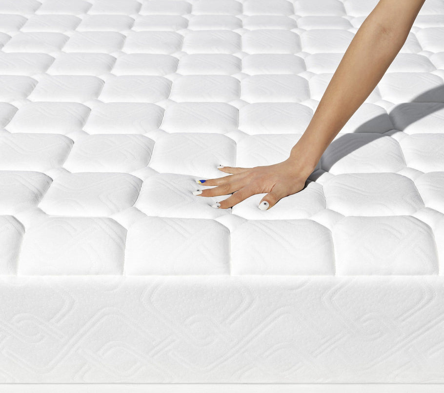 Hybrid - hand pressing on mattress