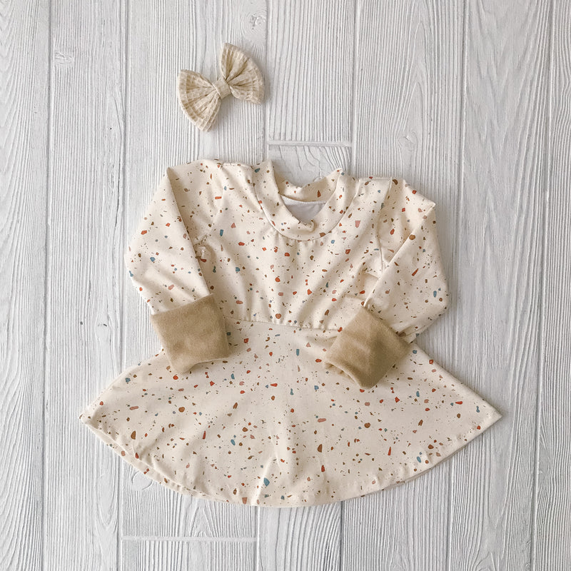 'Grow with Me' Neutral Peplum