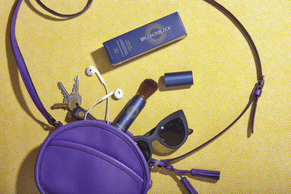 brush on block products spilling out of a purple purse