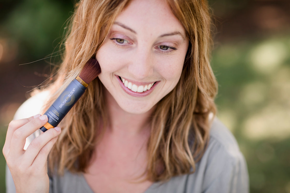 BRUSH ON BLOCK® image of woman applying mineral powder sunscreen