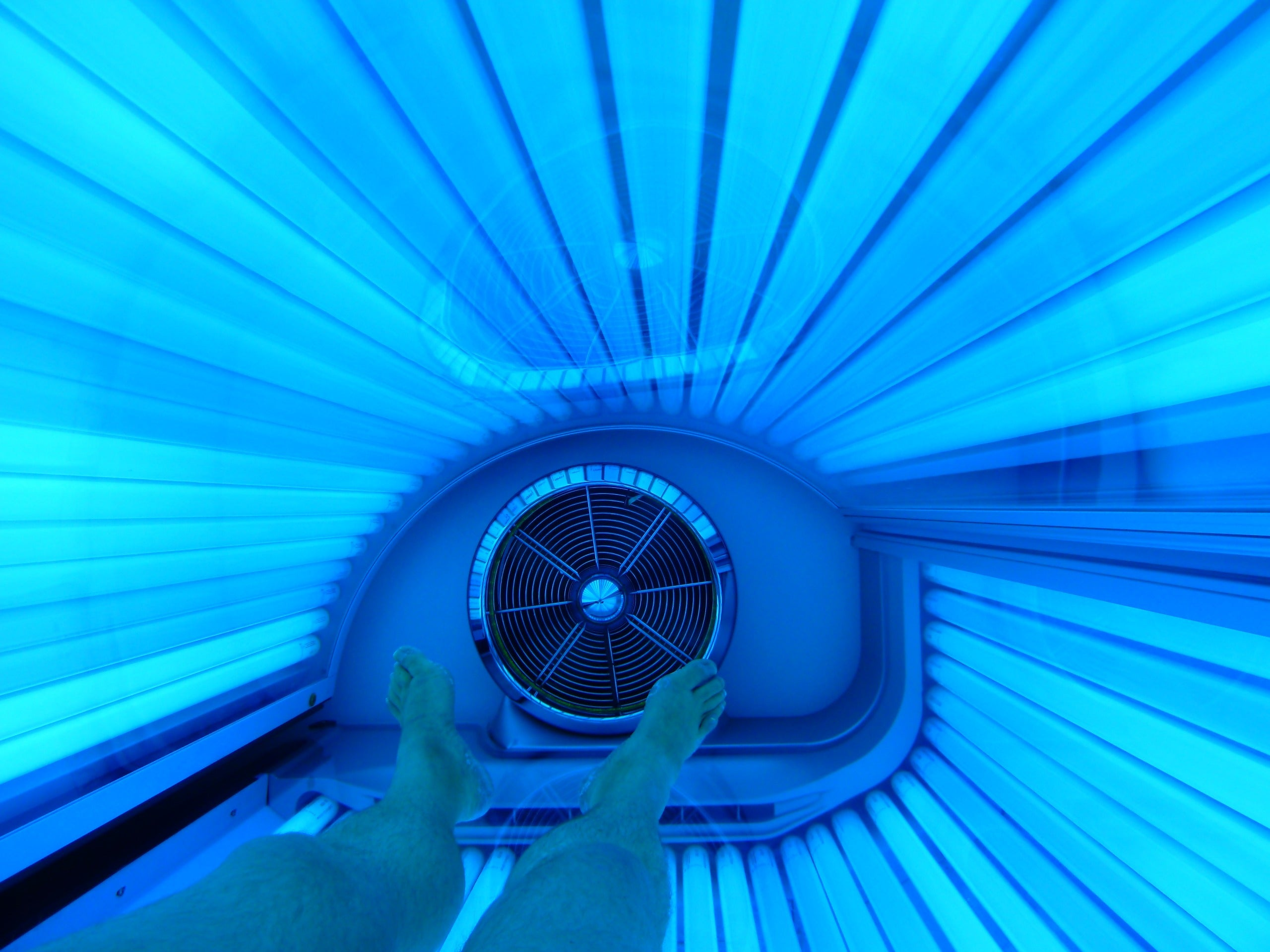 BRUSH ON BLOCK® image inside of tanning bed