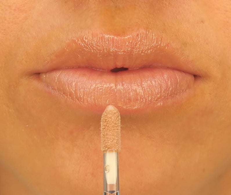 Brush On Block image of lips wearing Protective Lip Oil