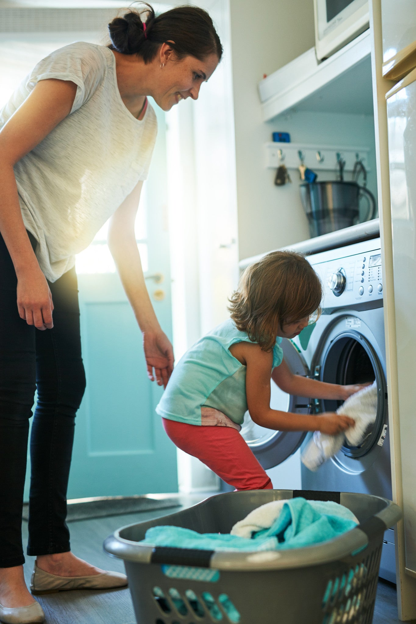 Brush On Block image of child helping mother with laundry