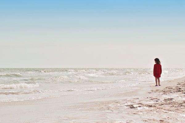BRUSH ON BLOCK® image of young girl standing on beach.