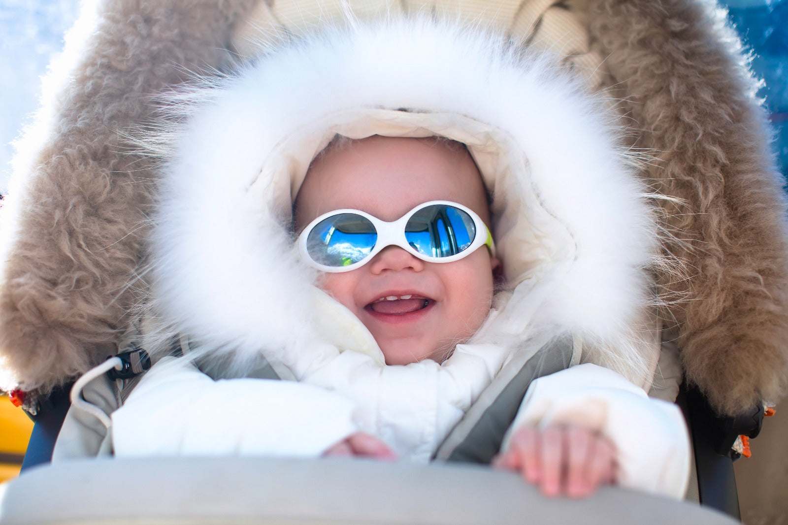 Brush On Block image of baby in parka and sunglasses