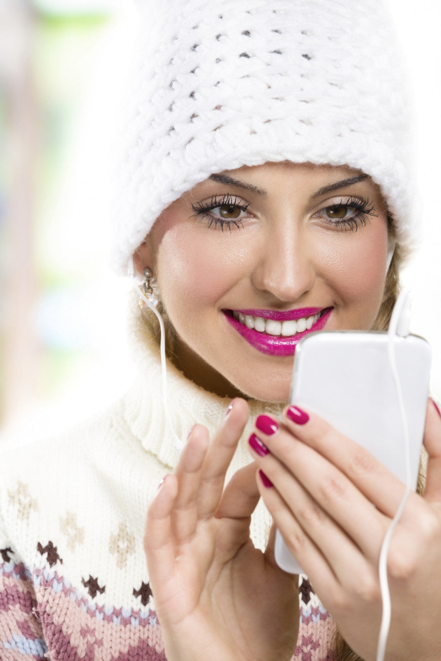 Brush On Block image of woman wearing makeup looking at smart phone.