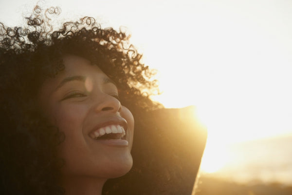 Brush On Block image of woman enjoying sunshine