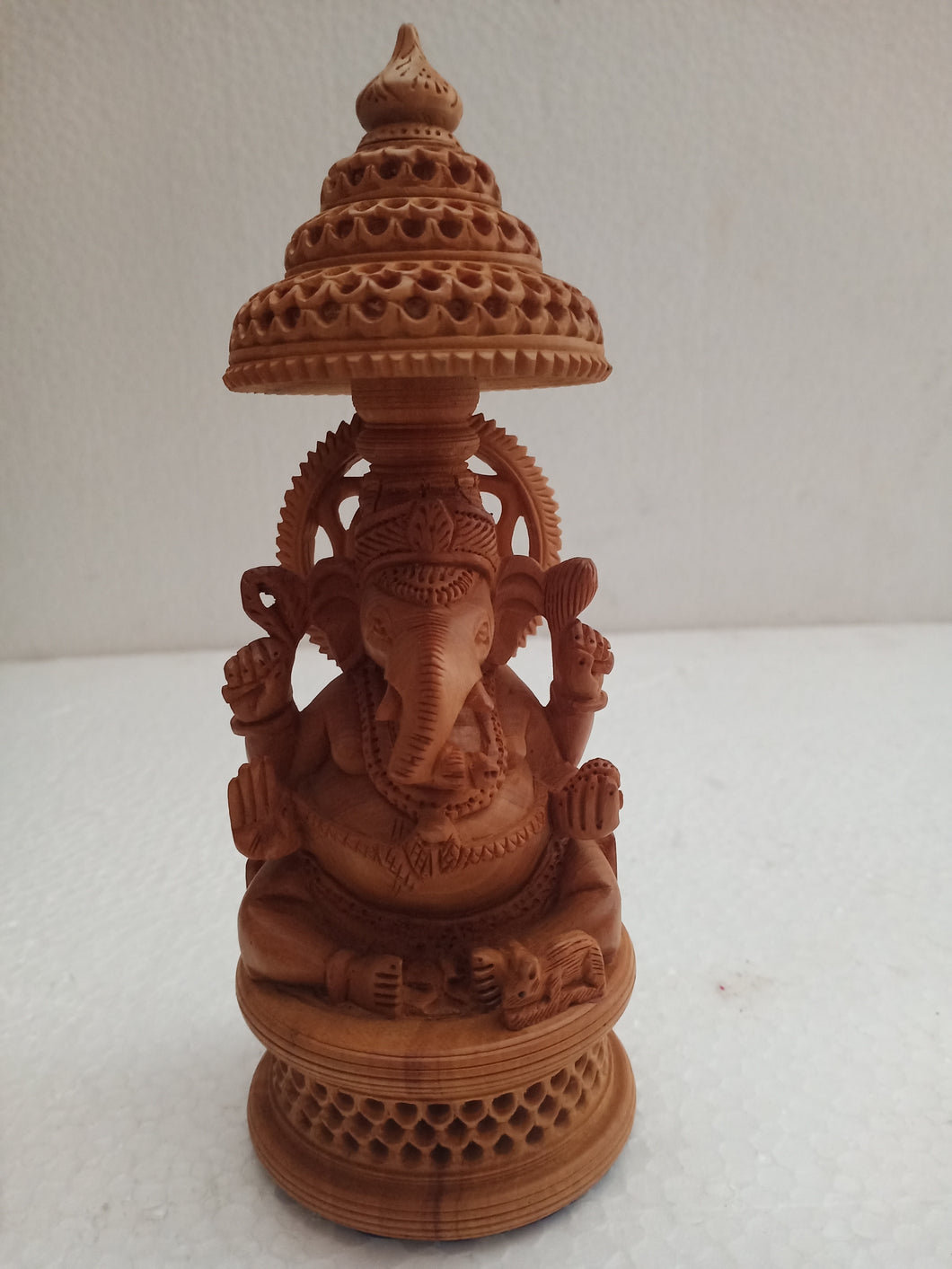 White wood. Curving Ganesh
