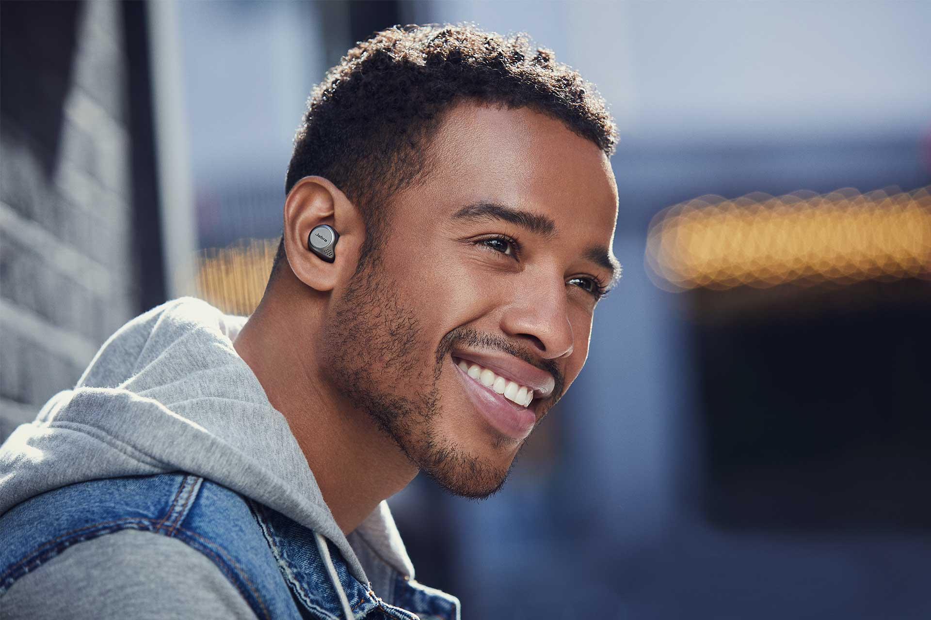 Jabra Elite 75t True Wireless Earbuds for Active Lifestyle - Male Model Smiling