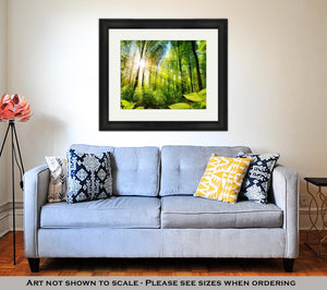 Framed Print, Scenic Forest Of Fresh Green Deciduous Trees Framed By Leaves With The Sun