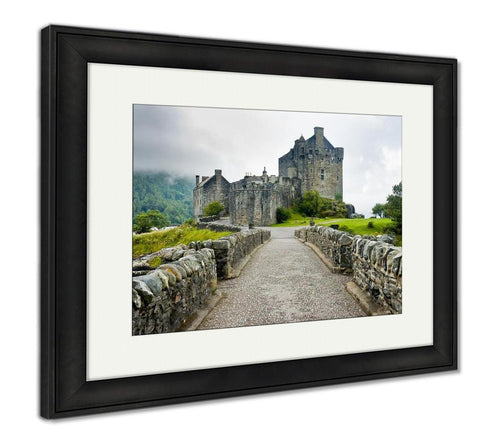 Framed Print, View Of Eileen Donan Castle Scotland In Cloudy Day With Dramatic Light Travel