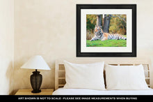 Load image into Gallery viewer, Framed Print, Tiger On Grass In Animal Kingdom In Orlando Florida