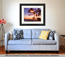 Load image into Gallery viewer, Framed Print, Hawaii Sunset With Fire Torches Hawaiian Icon Lights Burning At Dusk At Beach