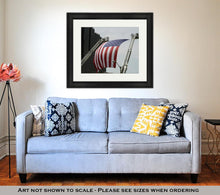 Load image into Gallery viewer, Framed Print, A Large American Flag Hanging Between Firefighter Truck Ladders