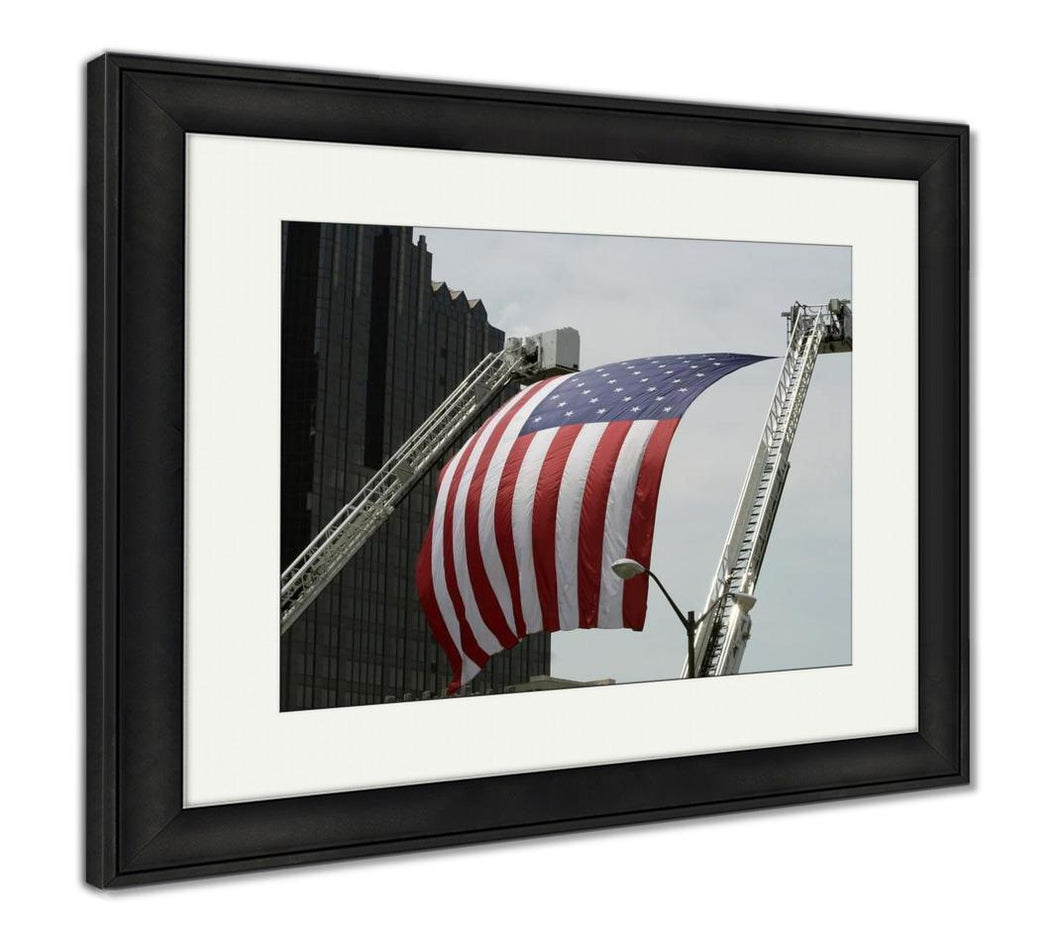 Framed Print, A Large American Flag Hanging Between Firefighter Truck Ladders