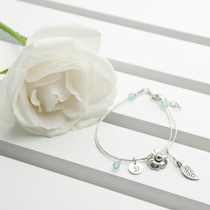 Personalised Forget Me Not Friendship Bracelet With Blue Topaz Stones