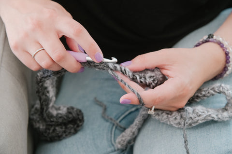 two hands crocheting