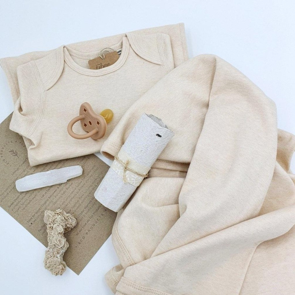 Sweet Desert Rose | Eco Baby Bundle Filled with soft, warm natural hues, a uniquely beautiful bundle perfect for your aby. A combination of soft organic fabrics, neutral tone, Selenite crystal presented in our very own handmade paper to symbolize protection, strength, and purity.