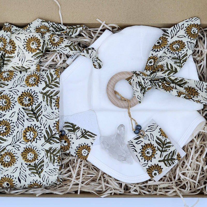 Sunflower Kisses Snuggle Bug Baby blanket | zizou $29.95  This enchanting baby sunflower blanket is a beautiful little friend that will grow with your child.  A great friend that can be a security blanket, teether, and plush all in one.  The design is unisex and in a breathtaking leaf print. You can style your buddies hair in many styles, Dread Locks, headscarf and down and free.  Made from soft cotton cloth and eco-friendly vegetable dyes, organic cotton filling