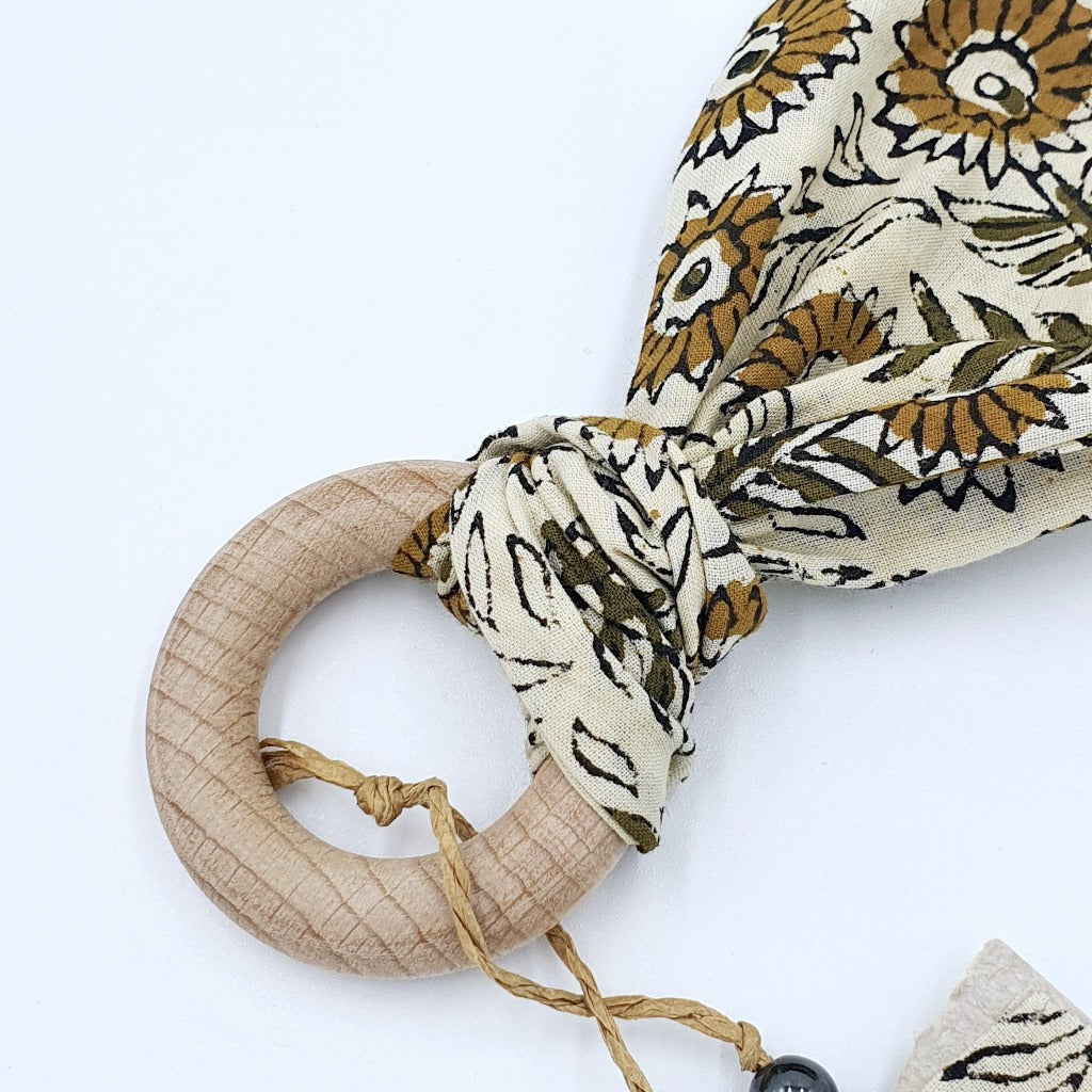 Sunflower Kisses Beachwood Teether | zizou $18.95  This teether is part of the Sunflower Kisses range by zizou. Made out of Beachwood and soft eco-friendly vegetable-dyed cotton, This cute boho teether is not only the cutest thing you see but perfect for your baby. Fabric is removal, allowing for easy washing.
