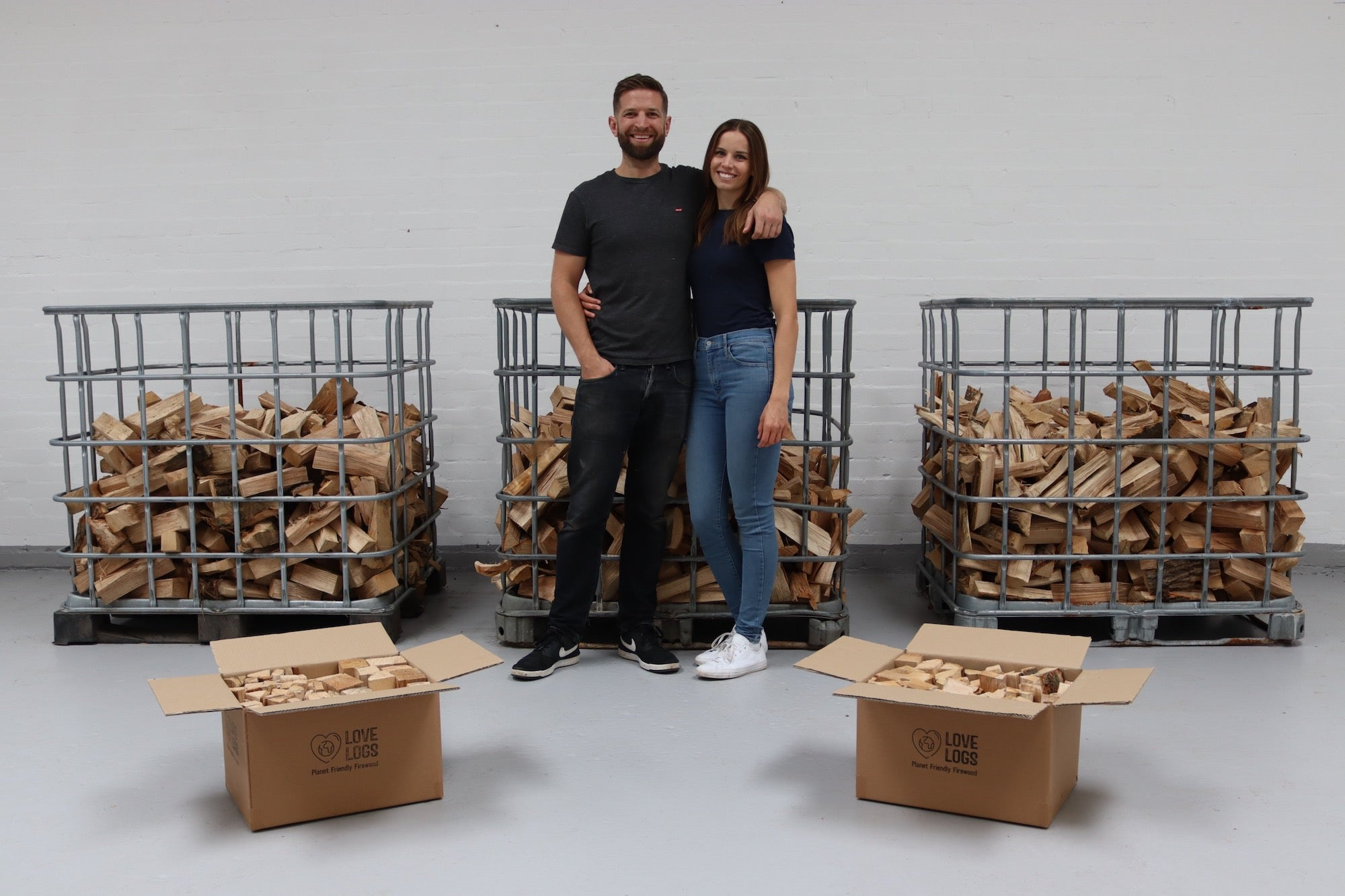 Paul and Heather in the warehouse after launching Love Logs Planet Friendly Firewood