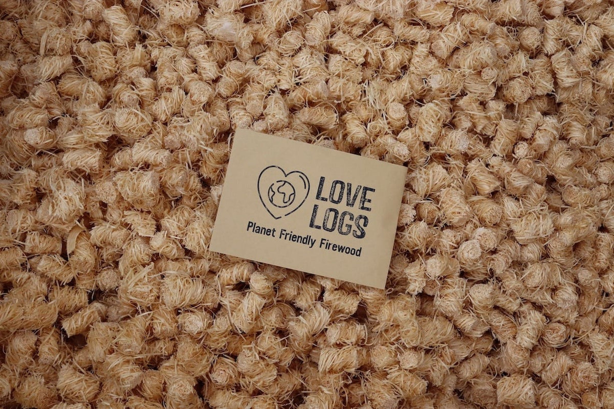 Natural firelighters and Love Logs logo