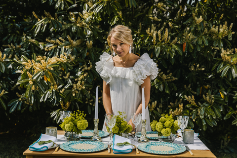Kate Fairlie in front of Aqua Pearl Tablescape