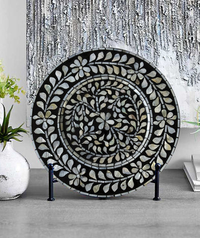 Black mother of pearl charger plate on display