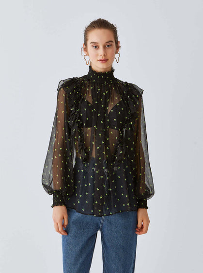 Sheer Sleeveless Polka Dot Turtleneck