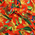 Orange Background with Multicolored Leaves and Animals Printed Fabric - Rex Fabrics