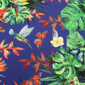 Blue Background with Green and Orange Leaves Monstera Printed Fabric - Rex Fabrics