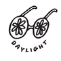 hand drawn logo of sun glasses with flowers for eyes and the word daylight written as the sm
