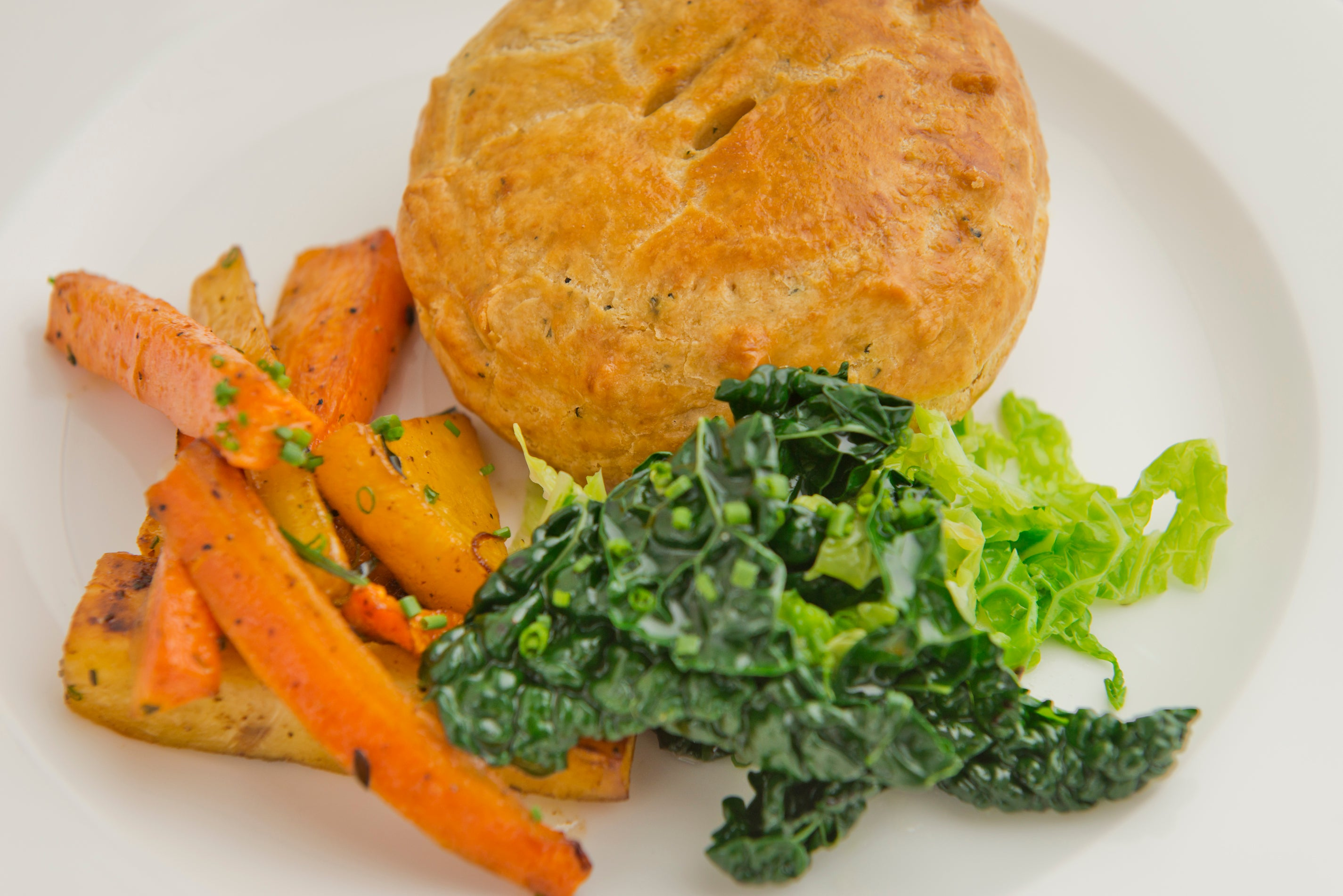 Potato, leek & Cornish Yarg pie with roast root vegetables (V)