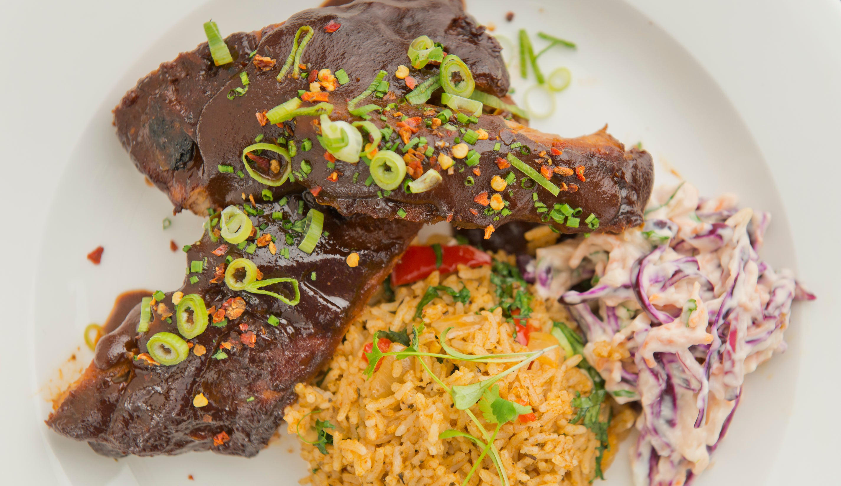 BBQ pork ribs with spicy rice & coleslaw