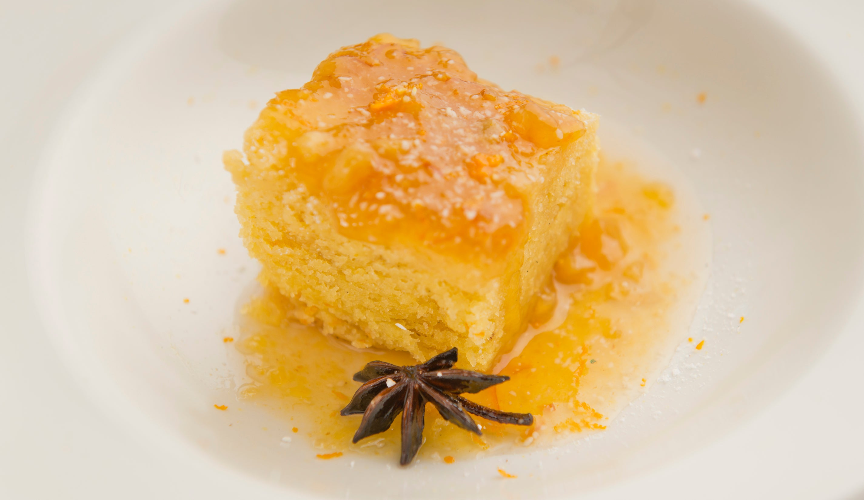 Orange & stem ginger steamed pudding with crème Anglaise (V)