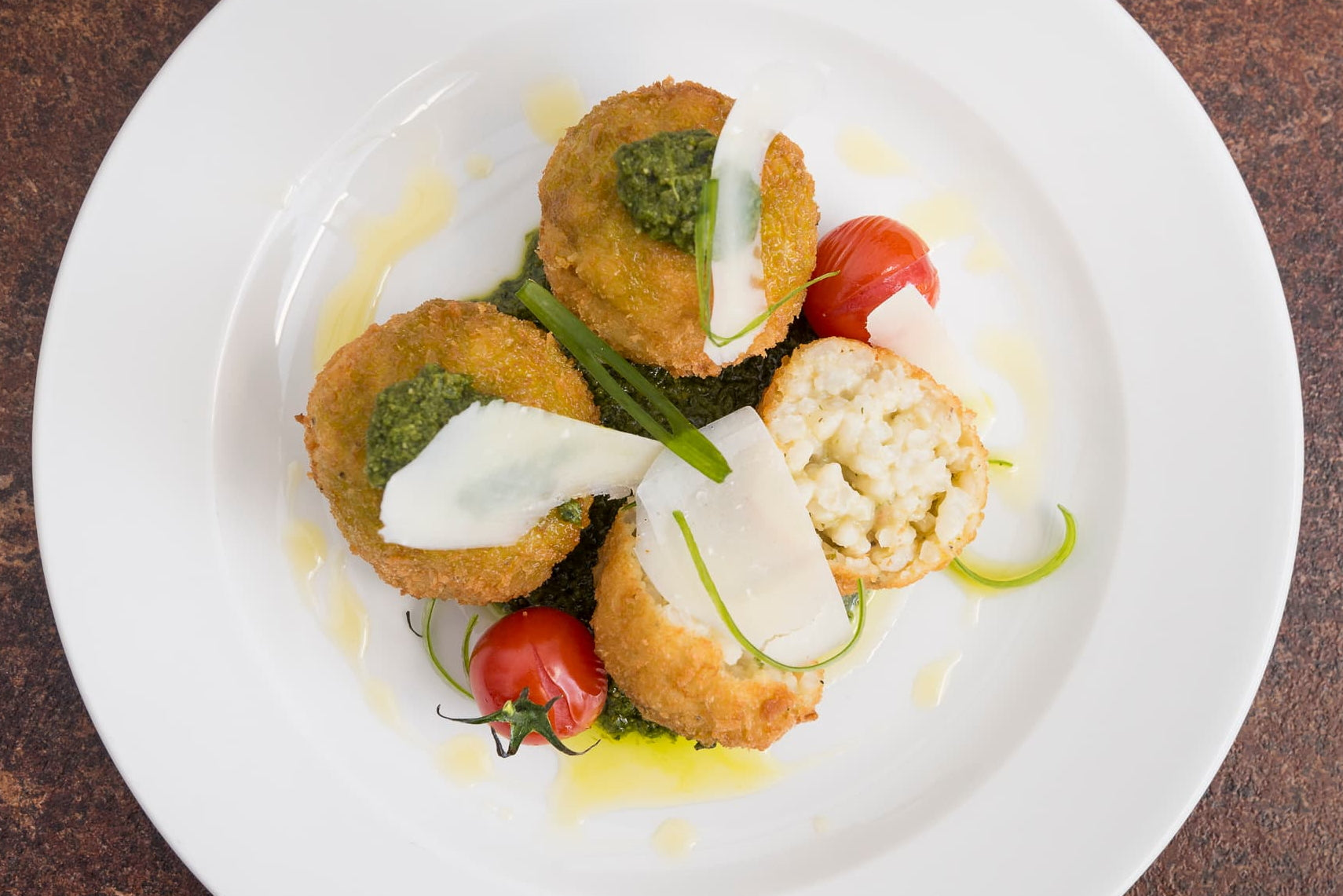Sun-dried tomato & parmesan arancini – rocket pesto for one or two to share (V)