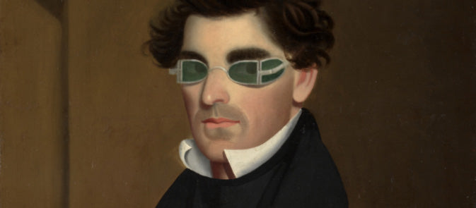 A man with rudimentary sunglasses. Likely due to syphilis