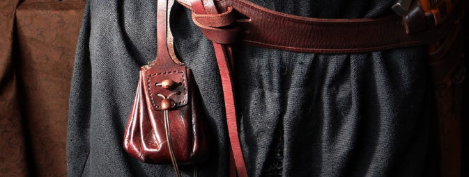 A leather coin pouch worn on the belt