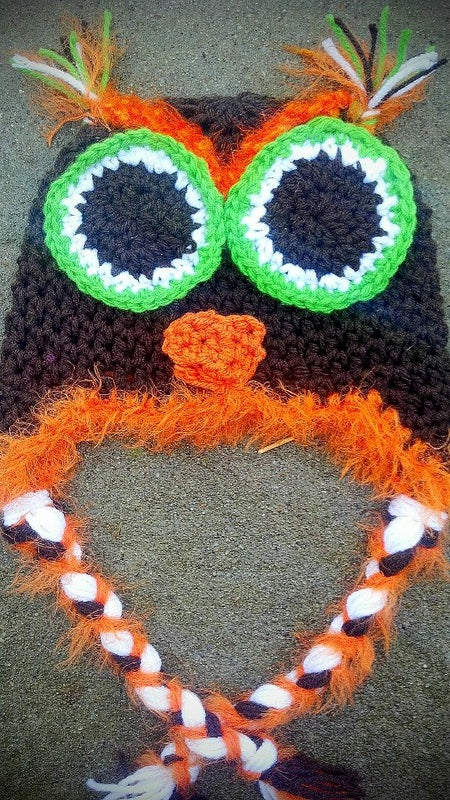 Brown owl with orange and green accent
