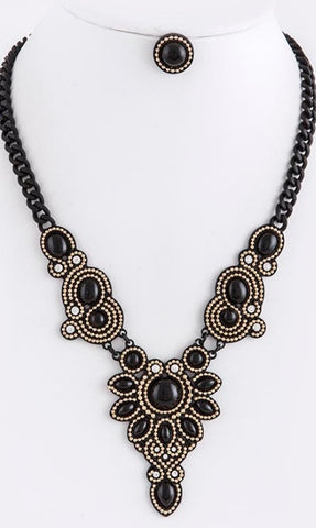 black and gold necklace and earrings