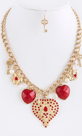 red gemstone lined heart necklace