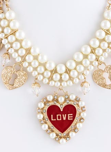 pearls and gold heart shaped necklace