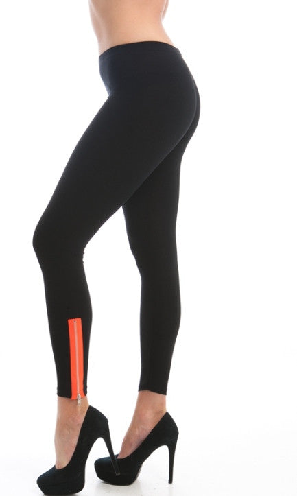 orange accented zipped ankle black leggings