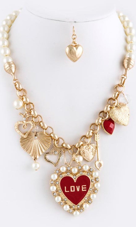 heart lined necklace with partial pearl chain and heart shaped earrings