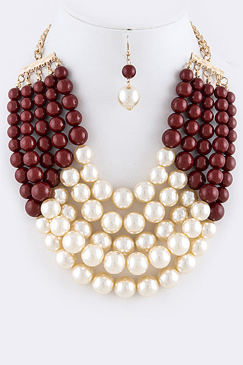 burgundy and cream pearl necklace and pearl earrings