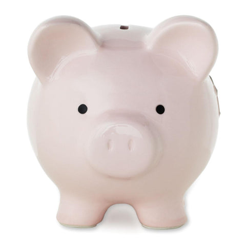 Pink piggy bank with cross