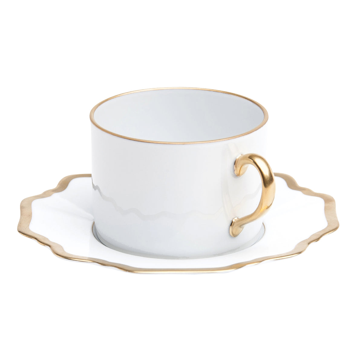 Antique White and Gold Tea Cup and Saucer