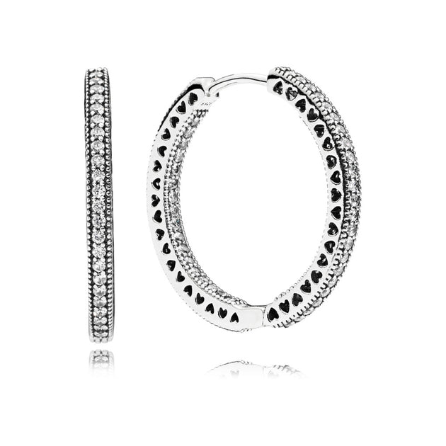 Hoop earrings in sterling silver with clear cubic zirconia and cut-out heart details