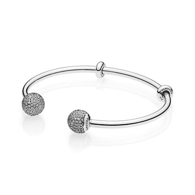 Open bangle in sterling silver with interchangeable end caps with 254 pave - set clear cubic zirconia and stoppers