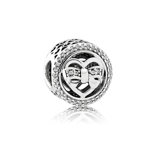 Heart charm in sterling silver with clear cubic zirconia in bow detail and cut-out heart pattern
